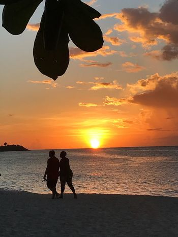 Grenada sunset. Caribbean Sunset Silloutte On The Beach Grenada Sunset People On The Beach Water Sunset Sky Sea Beach Silhouette Real People
