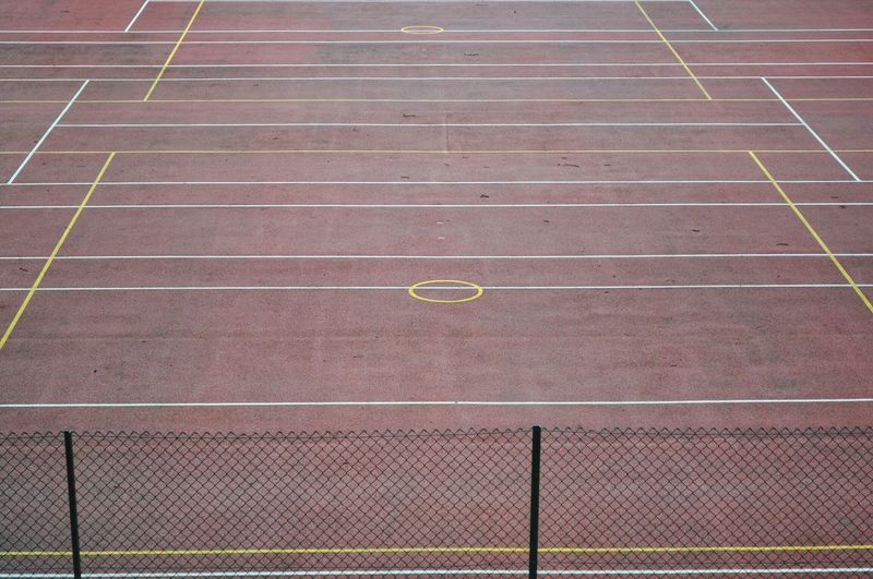 High angle view of chainlink fence on track and field