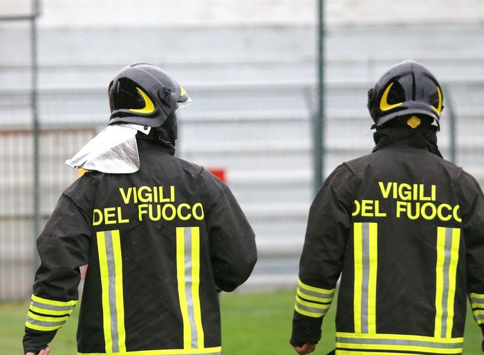 Italian firefighters with uniform with the written FIREFIGHTERS do the security service in the Stadium during the sporting event Emergency Firefighter Firemanatwork HERO Manhattan Men At Work  Milano Roma Stadium Textured  Uniform Vigili Del Fuoco  VigiliDelFuoco Working Firefighters Fireman People People At Work Pompiere Pompieri Surveillance Camera Turin Two People Vigili Written