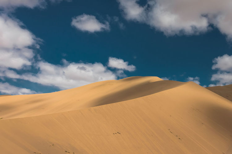 Mongolia Cloud - Sky Scenics - Nature Desert Landscape Sand Dune Sky Sand Climate Land Tranquil Scene Beauty In Nature Environment Arid Climate Tranquility Non-urban Scene Nature Day Remote No People Blue Outdoors