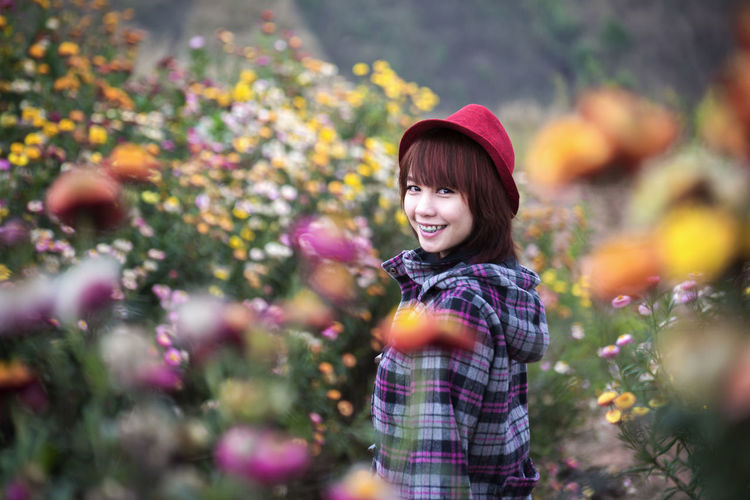 Girl with Blossom Portrait Adult Beautiful Woman Casual Clothing Day Emotion Flower Flowering Plant Hairstyle Happiness Looking At Camera Nature One Person Outdoors Plant Portrait Selective Focus Smiling Standing Waist Up Women Young Adult Young Women