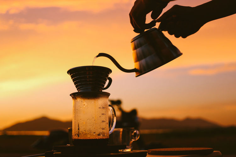 Coffee time against sunset sky.