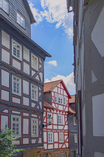 Building Exterior Architecture Built Structure Sky Cloud - Sky Building No People City Nature Communication Residential District Window Day Low Angle View Outdoors Text House Western Script Sign Town Fachwerkhäuser Marburg Oberstadt Schönes Wetter