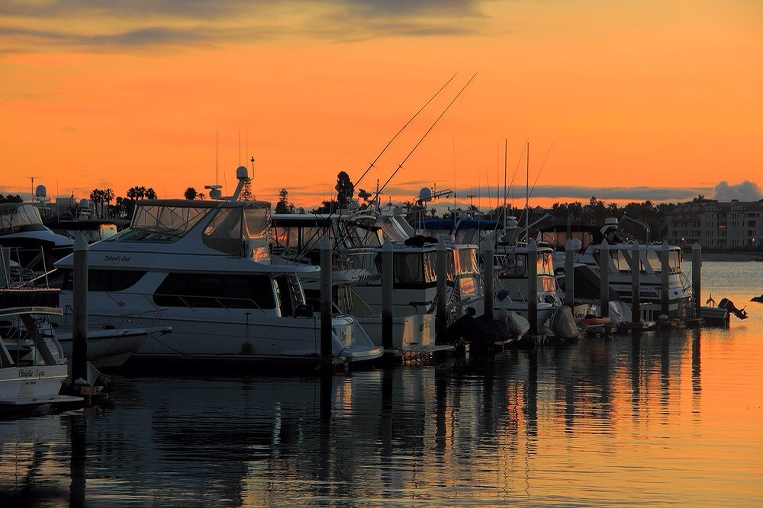 sunset, nautical vessel, water, transportation, mode of transport, orange color, boat, waterfront, moored, harbor, building exterior, sky, sea, architecture, built structure, crane - construction machinery, commercial dock, mast, crane, sailboat