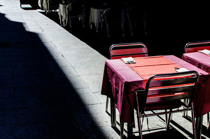 An terrazza in one of the narrown streets of Madrid at the centre of the city. Chairs City Day No People Outdoors Outside Pink Red Red Restaurant Shadow Sunlight Table Terrazza Tourism Travel Travel Destinations Traveling