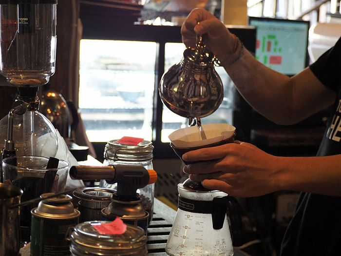 Cropped Image Of Man Preparing French Press Coffee In Cafe