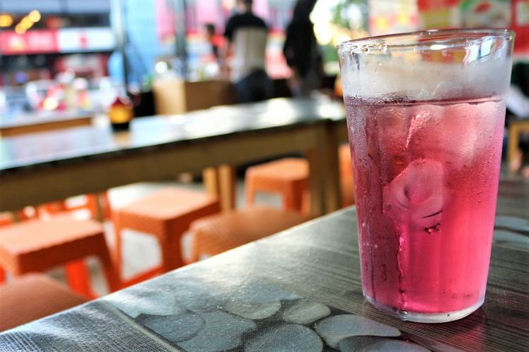 Close-up of cold drink on table