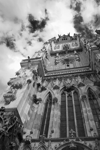 Low angle view of regensburg cathedral against sky