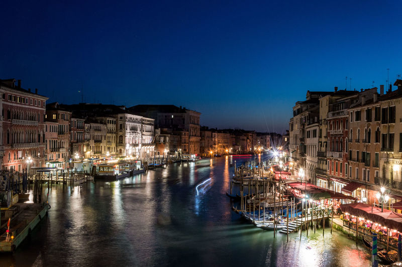 High angle view of illuminated grand canal against sky at night