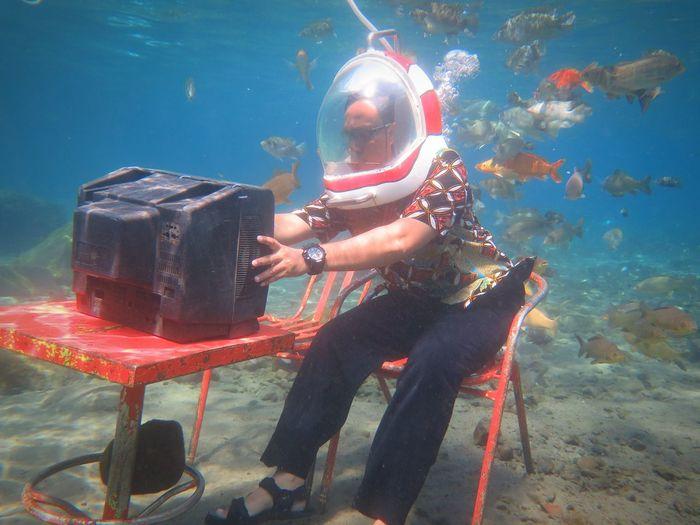 Man watching tv in sea