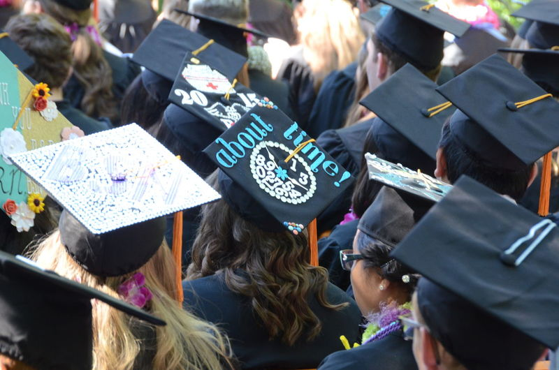 Rear view of graduates wearing hat during event