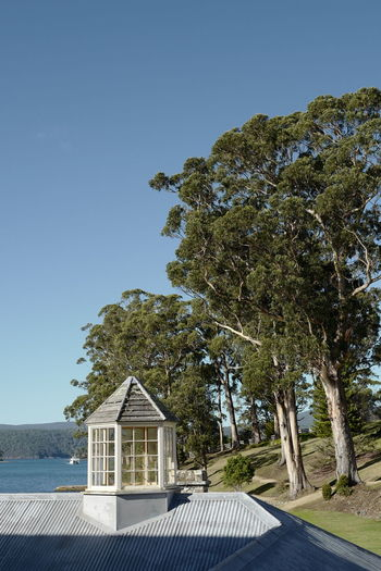 Shot in Tasmania, Australia. Architecture Beach Beauty In Nature Blue Building Exterior Built Structure Clear Sky Day Nature No People Outdoors Scenics Sea Sky Tranquility Tree