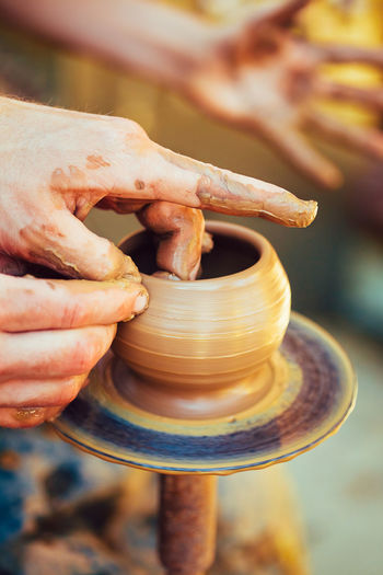 Pottery Craft Wheel Ceramic Clay Potter Human Hand. Toned Instant Photo Creativity Inner Power Skill  Touch Work Brown Ceramic Clay Close Craft Design Earthenware Experience Finger Hand Handmade Hobby Inspiration People Potter Sensory Small Toned Traditional Small Business Heroes