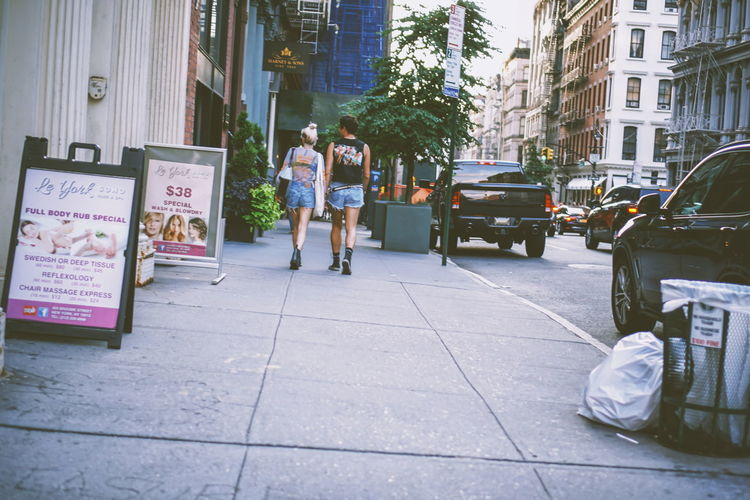Sidewalk New York NYC Downtown District Fashion Streetphotography Street Photography Walk Walking Walking Around Movement City Life Urban Scene City Young Women Full Length Women Togetherness Men Friendship Sidewalk City Life Business Finance And Industry Store Streetwise Photography The Mobile Photographer - 2019 EyeEm Awards The Street Photographer - 2019 EyeEm Awards