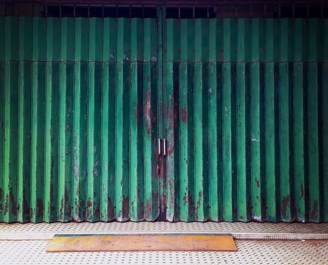 The old gate | green colour | entrance door Old Style Store Entrance Shop Entrance Old Gate Green Gate Gate Door Green Color Pattern Metal No People Architecture Security Wall - Building Feature Protection Entrance Sign Closed Fence