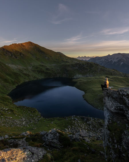 Sunrise at a mountain lake in Austria. Scenics - Nature Mountain Beauty In Nature Water Tranquil Scene Sky One Person Tranquility Real People Nature Rock Leisure Activity Rock - Object Non-urban Scene Lifestyles Solid Lake Mountain Range Outdoors Looking At View Norway Austria Mountain Lake Mountain View Sunrise My Best Photo