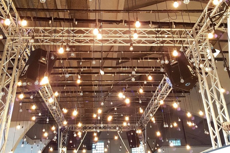 Lights Shine Industrial Framework Scaffold Hamburg Holsten Brewery Festival Illuminated Backgrounds Lighting Equipment Ceiling Arts Culture And Entertainment Electric Light Entertainment Electricity  Bulb Light Bulb Stage Light Sparks