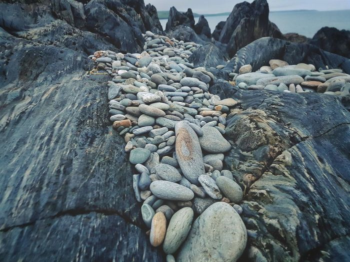 High Angle View Of Pebbles On Rock Formation