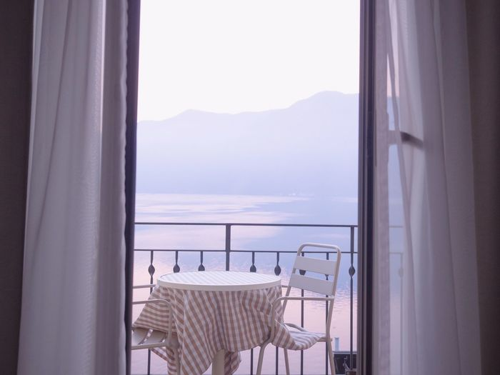 Window Indoors  Curtain No People Seat Absence Transparent Chair Glass - Material Day Mountain Home Interior Nature Sky Clear Sky Empty Table Door Architecture Glass Lake View Sunrise