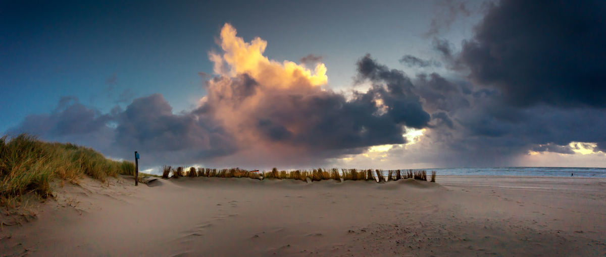 Sky Cloud - Sky Beach Water Beauty In Nature Nature Panoramic Sand Tranquil Scene Power In Nature Outdoors Sunset No People Tranquility Landen Landscape_Collection Sea The Netherlands Holland