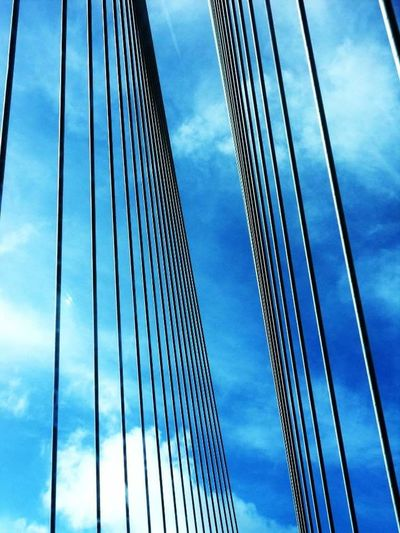 Pont Connection Sky Suspension Bridge Bridge - Man Made Structure Architecture Cloud - Sky Low Angle View Outdoors Built Structure Day City Pattern No People Steel Cable Cable-stayed Bridge Cable Skyscraper Building Exterior Downtown District Nature