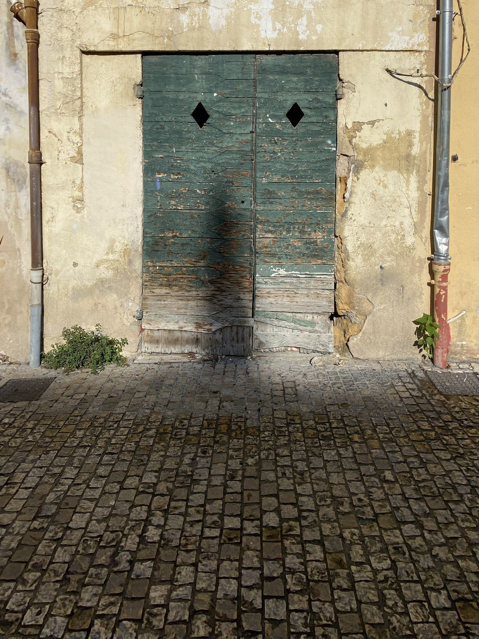 architecture, door, built structure, entrance, building exterior, building, street, cobblestone, city, no people, footpath, day, closed, outdoors, old, security, protection, stone, paving stone, safety
