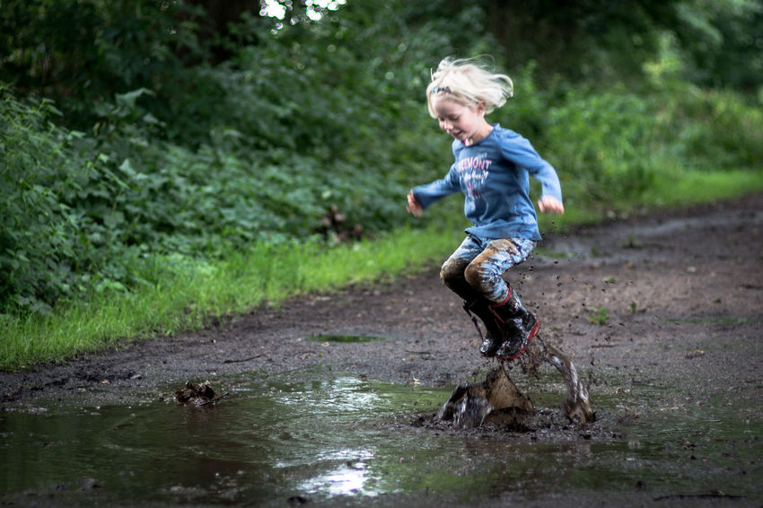 having fun Children EyeEm Best Shots Fun Jump Kids Being Kids Pure Action Activity Blond Hair Child Childhood Children Only Day Full Length Jumping Little Girl Nature One Person Outdoors Play Playing Puddle Water EyeEm Ready