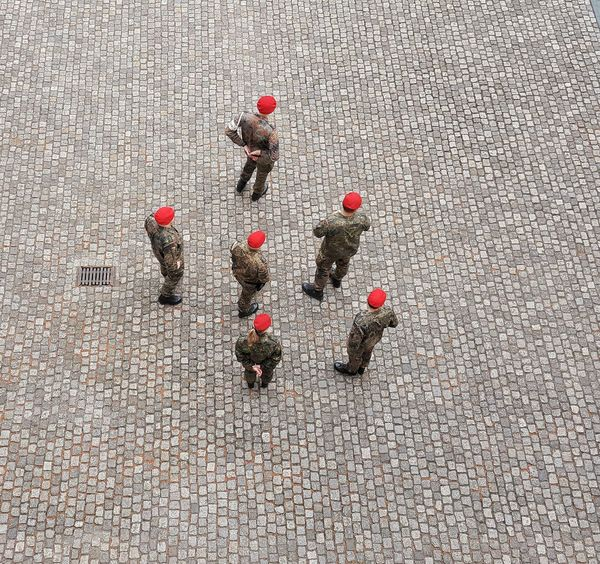 """""""pinheads?"""" Adult Adults Only AntiM Business Businessman Cooperation Coworker Day Directly Above Full Length Group Of People High Angle View Large Group Of People Men Military Police The Photojournalist - 2017 EyeEm Awards The Street Photographer - 2017 EyeEm Awards Outdoors People Red Red And Grey Strategy Teamwork Togetherness Young Adult"""