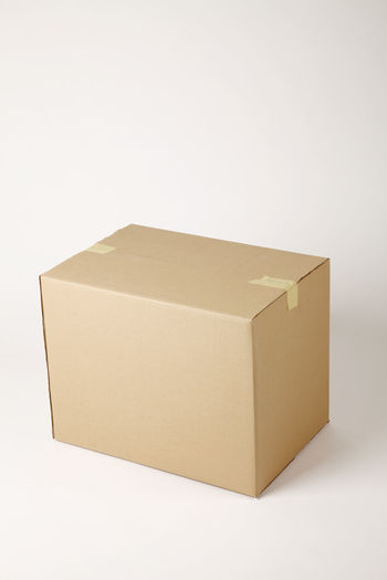 High angle view of brown cardboard box against white background