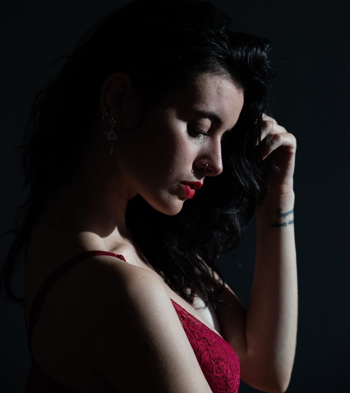 one person, young adult, studio shot, women, young women, indoors, beautiful woman, looking, beauty, headshot, black background, portrait, red, contemplation, make-up, lifestyles, lipstick, hair, looking away, fashion, hairstyle