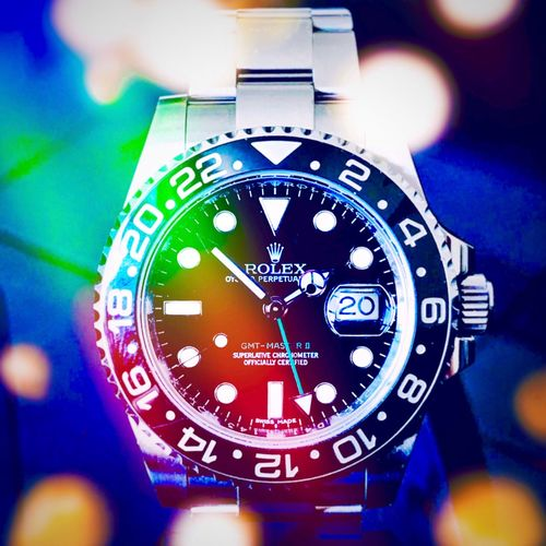 Fun with lights & reflections, shot on an IPhone. Light Beam Lens Flare Bokeh Shot On IPhone Rolex Reflection Number Close-up No People Indoors  Time Focus On Foreground Watch Wristwatch Accuracy Clock Illuminated Still Life Detail Geometric Shape Glowing