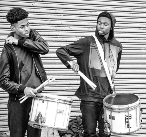 Boys Confidence  Drums Harlem  Music Performance Rhytm Street Streetphotography Well Turned Out Stories From The City I saw them like that waiting to start a rhythm for the girls dancing next to them. The city offers a non stop scene for the expression of madly creative impulses. Nothing should surprising everything is to be expected and we are all invited to make an entrance.