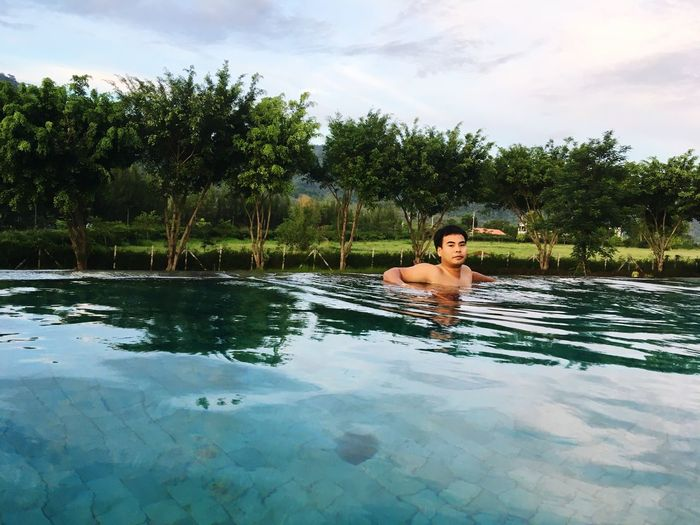 #swimming #Swimming Pool #dusit #dusitd2 #dusithotel #dusitthailand #relaxing #relax Water Tree One Person Plant Real People Swimming Pool Sky Pool Shirtless Lifestyles Waterfront Leisure Activity Young Adult Cloud - Sky Nature Young Men Day Vacations Outdoors