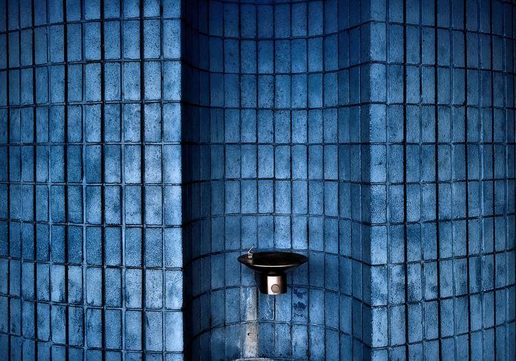 Washbasin On Blue Brick Wall