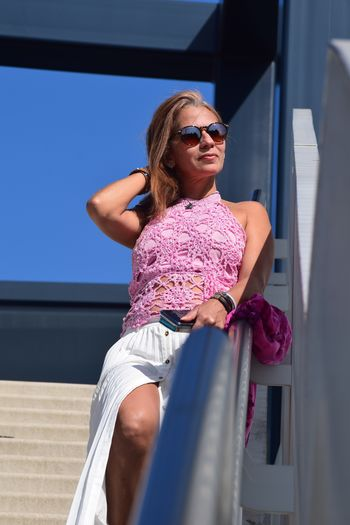 Low angle view of woman with sunglasses