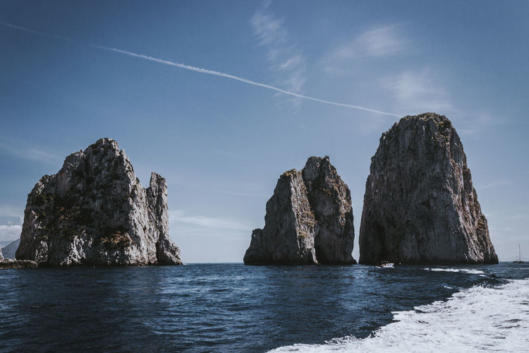 Faraglioni di Capri Faraglioni Capri Faraglioni Water Sea Sky Rock Scenics - Nature Beauty In Nature Rock - Object No People Tranquility Tranquil Scene Solid Nature Vapor Trail Rock Formation Waterfront Day Cloud - Sky Horizon Idyllic Outdoors Horizon Over Water Stack Rock