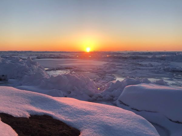 Lake Superior icy morning! EyeEmNewHere EyeEm Best Shots Peace Nature Scenics Colour Your Horizn Tranquil Scene Frozen Ice Winter Sun Sky Orange Color Outdoors No People