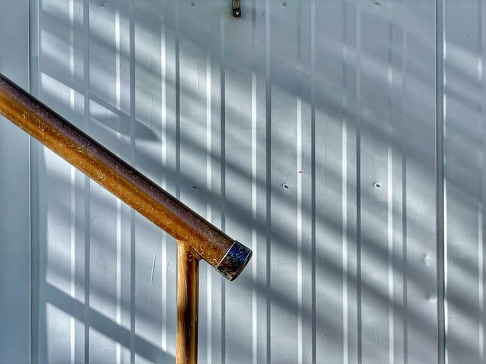 High angle view of metal grate on wall