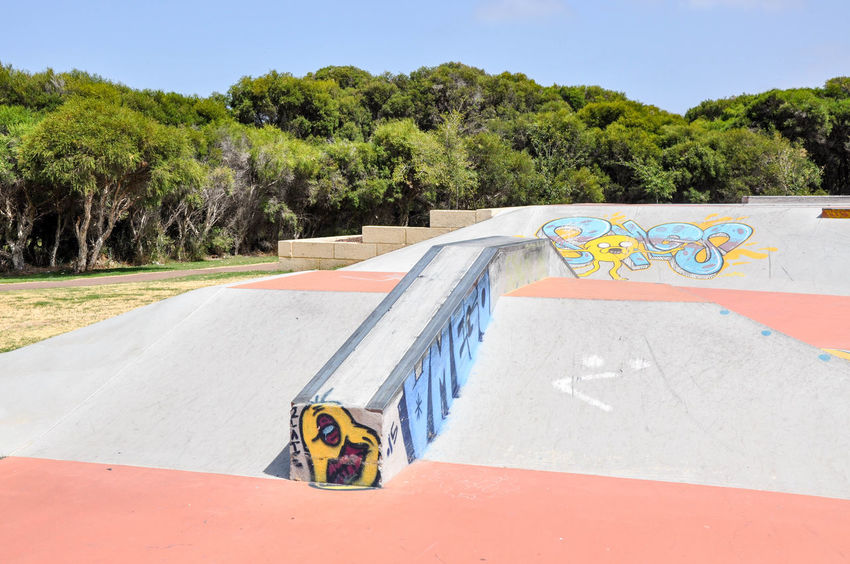 Concrete playground with urban art at the Spearwood Skate Park in Western Australia Colorful Concrete Day Design Expression Graffiti Greenery Mural No People Outdoors Playground Rails Ramps Recreation  Skatepark Spearwood Sport Tagging Tree Trees Venue Visual Statements Western Australia Youth Culture Youth Of Today