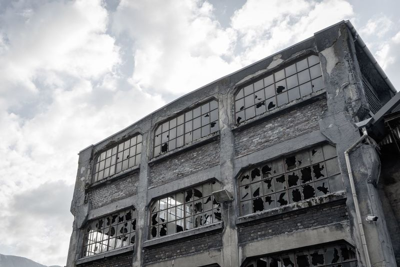 Abandoned Broken Glass Windows Dust Bricks Industrial Industry Burned Factory Abandoned Buildings Cloud - Sky Architecture Built Structure Sky Building Exterior Low Angle View Day Building History City