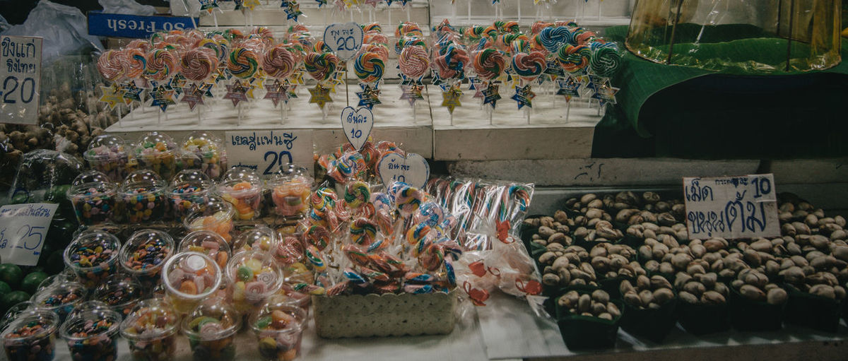 Various candies for sale at market stall