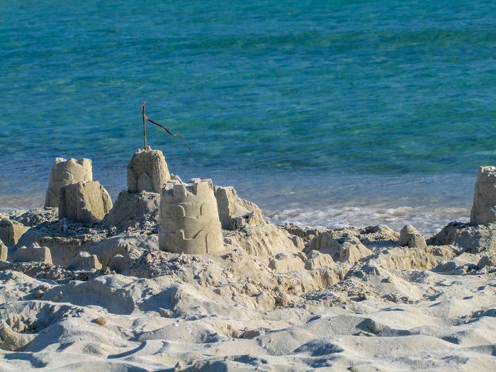 Scenic view of sand castles against sea