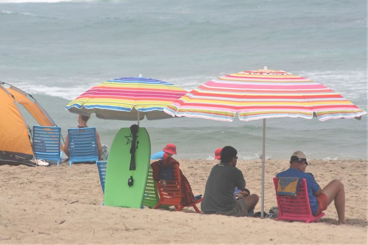 Holiday Beach Beach Umbrella KwaZulu-Natal Coast Leisure Activity Multi Colored Nature Outdoors Real People Relaxation Sand Sea Shelter Shore Sitting Summer Umbrellas Vacations