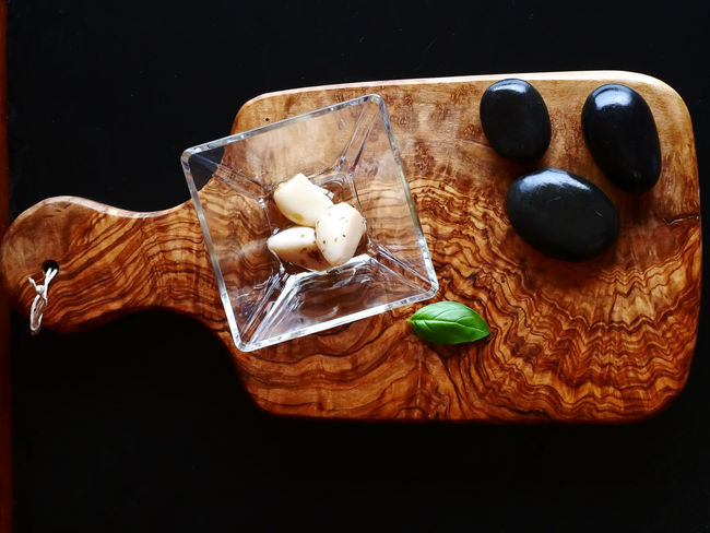 Basil Garlic Baked Black Background Close-up Cutting Board Dessert Food Food And Drink Freshness High Angle View Indoors  Indulgence No People Ready-to-eat Still Life Studio Shot Table Temptation Wood - Material