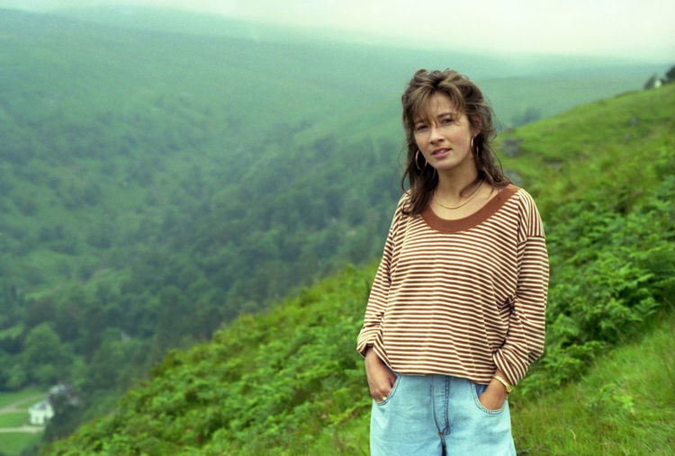 1990s Style Casual Clothing Focus On Foreground Hazy Day Hillside Looking At Camera One Person Outdoors Real People Standing Three Quarter Length Valley Young Adult