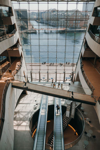 The Black Diamond, Copenhagen Denmark Library Modern Modern Architecture The Royal Danish Library Architecture Building Exterior Built Structure Copenhagen Glass - Material High Angle View Long Angle View Ocean Railing Reflection Sea The Black Diamond Travel Water Women EyeEmNewHere