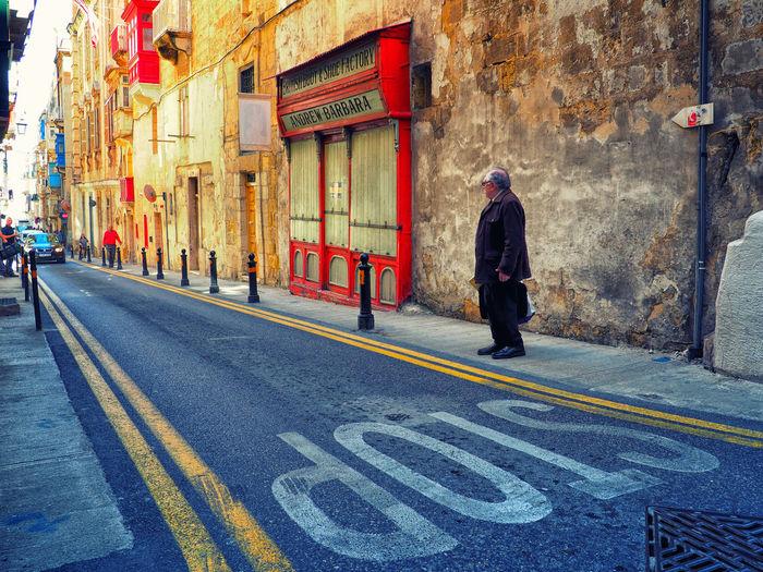 Man walking on road in city