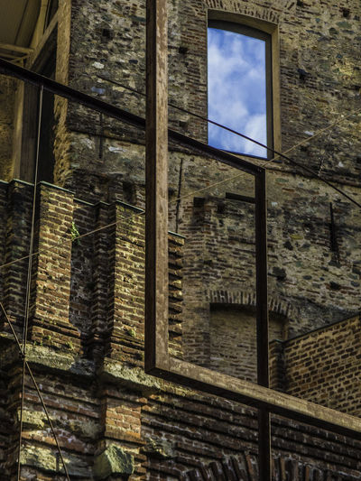 Prendimi 1+1=1 Abandoned Architecture Architecture Building Building Exterior Built Structure Damaged EyeEm Gallery EyeEmBestPics Glass - Material Indoors  Low Angle View Mllml No People Obsolete Old Pattern Playing With Thoughts Showcase April Sky Wall - Building Feature Window Dramatic Angles