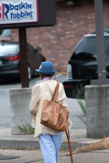 Lady In The Blue Hat Streetphotography Street Photography CanonXTI Carytown Richmond City Clothing Day Elderly Woman Focus On Foreground Hat One Person Real People Rear View Three Quarter Length Walking Walking Cane Street Scene