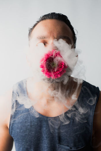 Man With Flower Emitting Smoke
